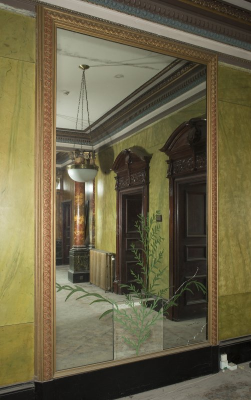 Ground floor, entrance hall, view of mirror on south wall