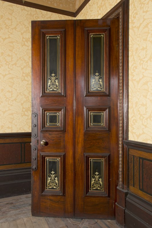 Ground floor, dining room, view of door with inlaid panels