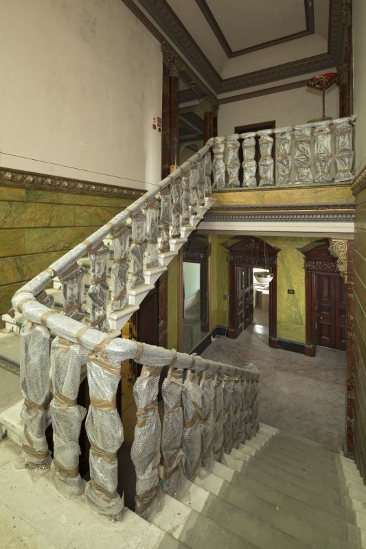 Ground floor, entrance hall and staircase, view from half  landing to east