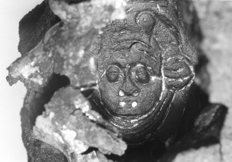 A segment of the concretion surrounding the sword-hilt (DP92/178) retains impressions of its original decoration, including the face of a putto or cherub. (Colin Martin)