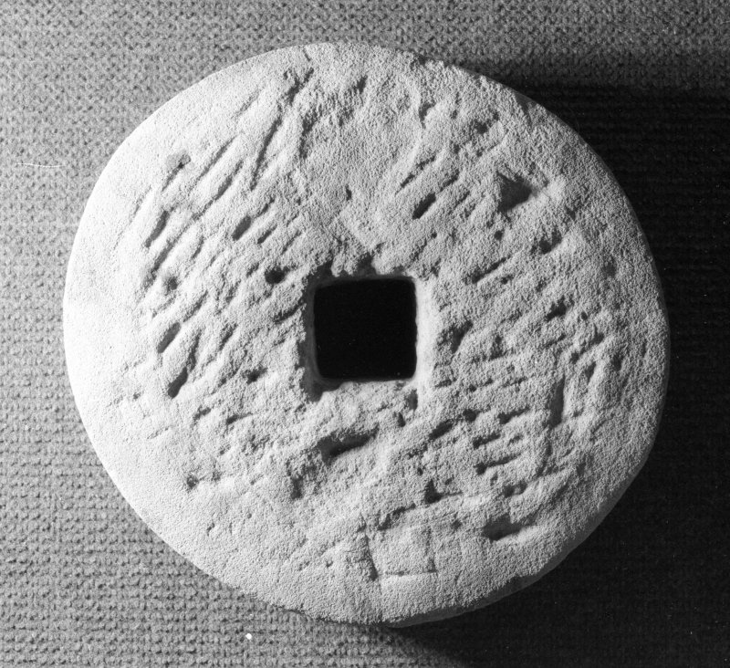 Rotary grindstone (DP92/DG13) with square spindle-hole, opposite face. Scale 25 centimetres. (Colin Martin)