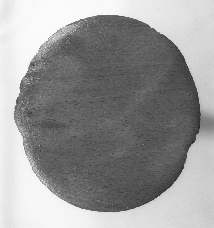 Wooden disk (DP00/159), diameter 145mm, perhaps a keg end. (Colin Martin)