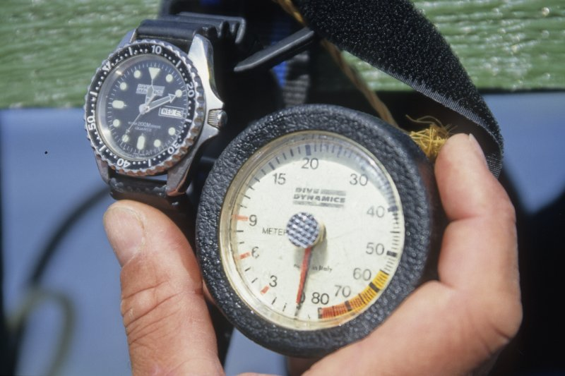 The two primary instruments with which the diver monitored his dive—a bezel watch and a metric depth-gauge. (Edward Martin)