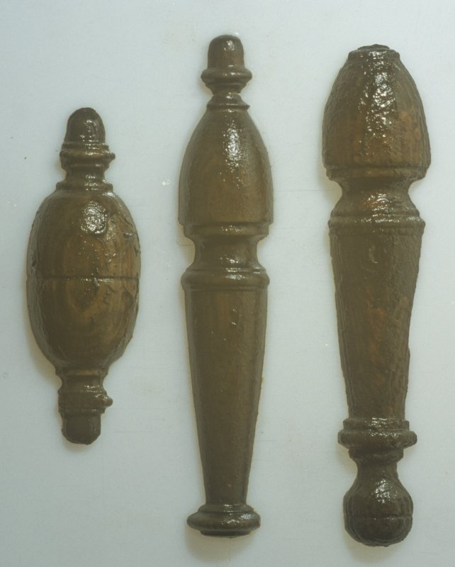 Turned half-sectioned decorative pieces associated with the interior panelling (left to right, DP97/A030, A018, un-numbered). (Colin Martin)