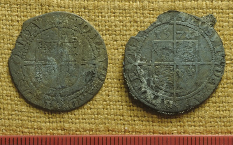 Two English silver shillings from the coin hoard (DP92/DG03) recovered by the Dumfries and Galloway Sub-Aqua Club in 1992. The date 1578 is clear on the right-hand coin but the latter two digits on the left-hand one are indecipherable. Scale in millimetres. (Colin Martin)
