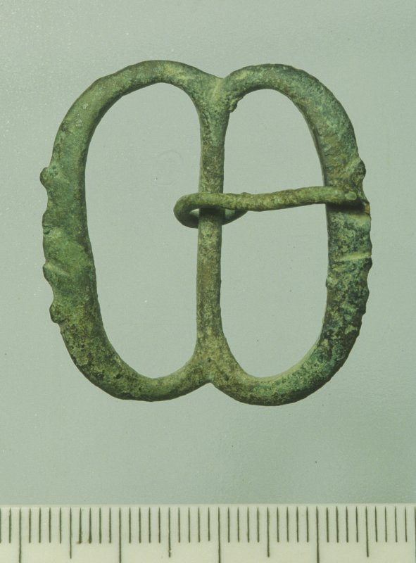 Brass buckle (DP92/256) recovered in 1992. Scale in millimetres. (Colin Martin)