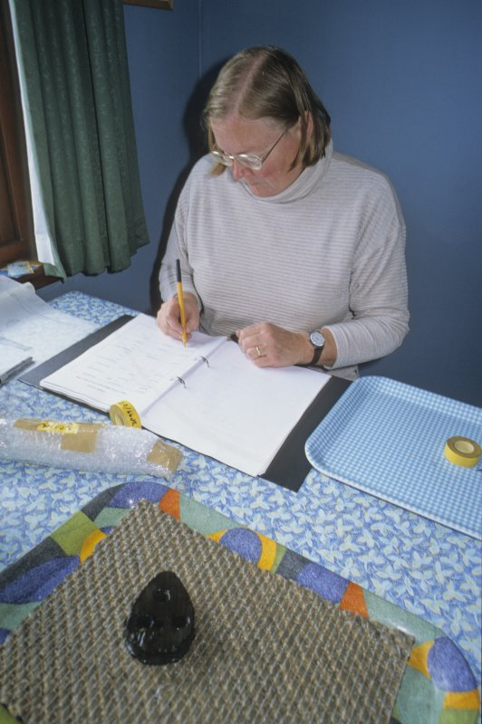 Dr Paula Martin fills in a record-sheet for each find, in this case a deadeye (DP99/037) from the ship's rigging, seen in the foreground. (Edward Martin)