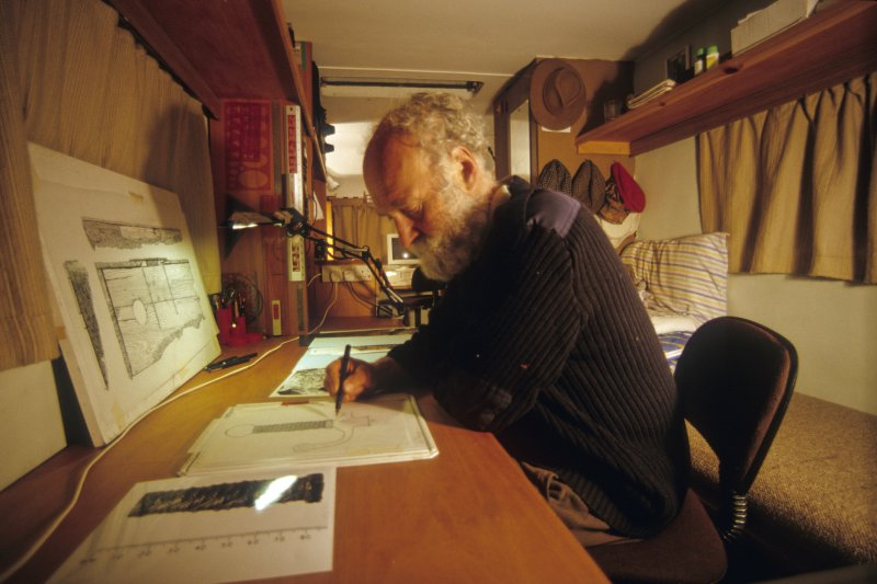 Dr Colin Martin preparing finds drawings in the headquarters caravan. (Edward Martin)