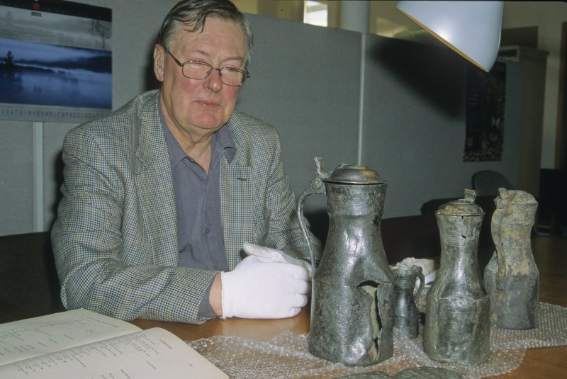Dr David Lamb, an authority on Scottish pewter, assesses finds from the wreck. (Colin Martin)