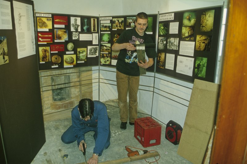 Neil Dobson (left) and Edward Martin setting up a permanent exhibition about the wreck and its background in Duart Castle. (Colin Martin)