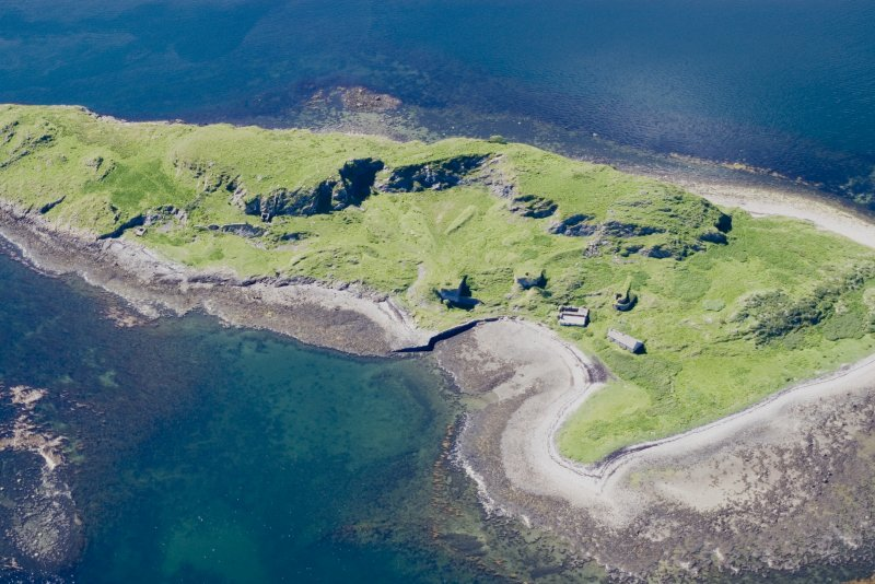 Aerial photograph of Sheep Island from the SE. The three kilns and associated buildings are clustered round the small bay. A built quay is visible at the left edge of the bay, while a presumably earlier cleared strip runs up the centre of the beach. Towards the left, just below the quarry face, is a gunpowder magazine, while there is another building of uncertain function above the foreshore further to the left. (Colin Martin)