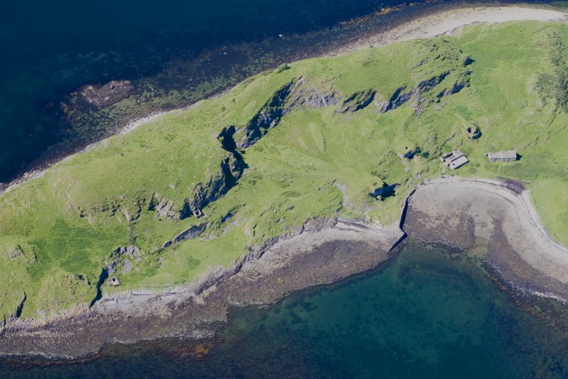 Aerial photograph of Sheep Island from the S. The three kilns and associated buildings are clustered round the small bay. A built quay is visible at the left edge of the bay, while a presumably earlier cleared strip runs up the centre of the beach. (Colin Martin)