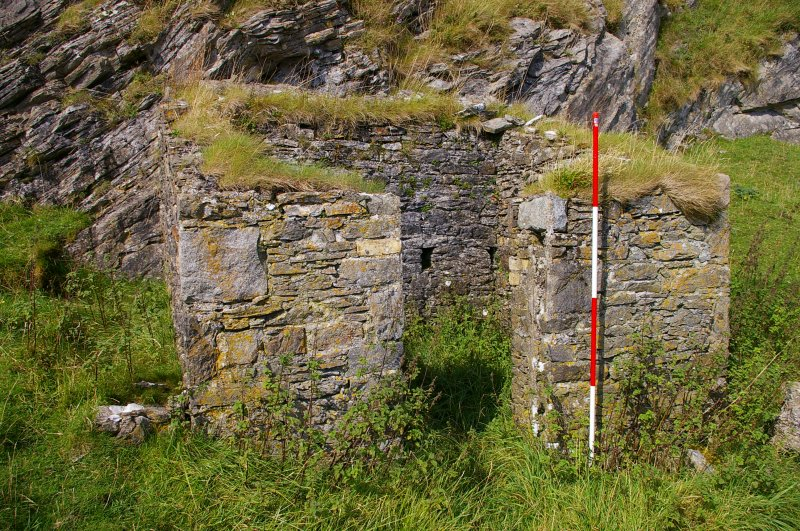 Small building set against the quarry face within a walled enclosure 40 m SW of the kiln complex. It is probably an explosives magazine. Scale 2 metres. (Colin Martin)