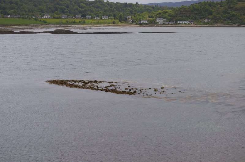 The reef (an Càrn = pile of stones) which appears to have been a ballast dump is exposing as the tide falls. Port Appin on the mainland shore lies beyond. (Colin Martin)