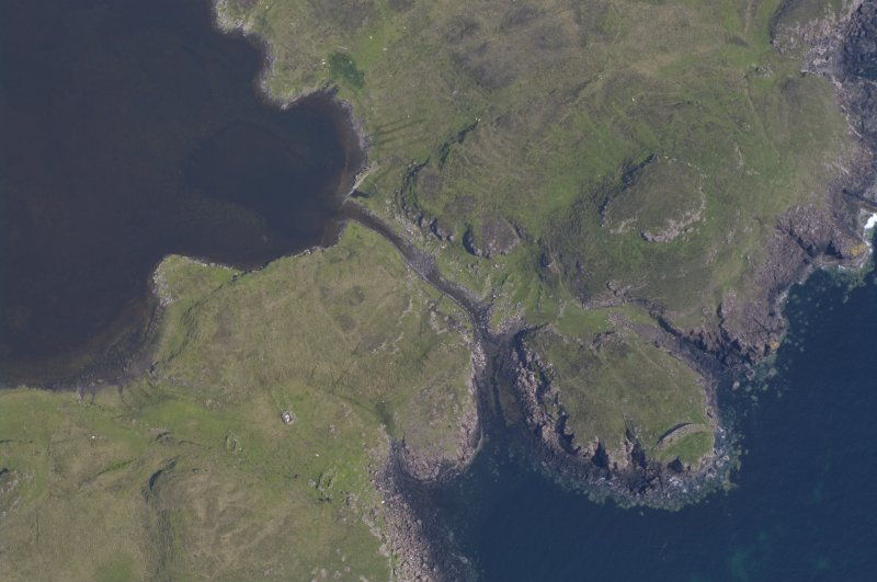 Aerial photograph of the headland fort and canal from the SW. Underwater indications of a stone-built quay can be seen on either side of the canal's entry to the loch. Beyond the canal entrance a ba ...
