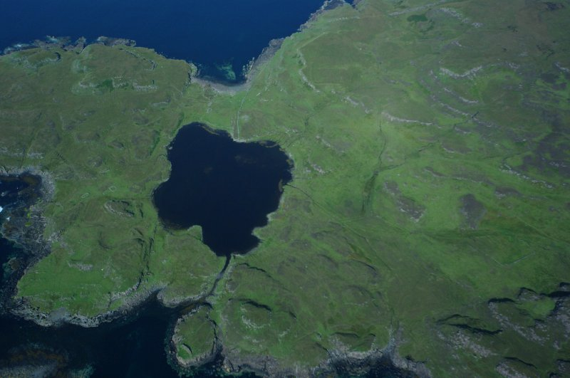 Aerial photograph of the headland fort, canal, and loch from the S. (Colin Martin)