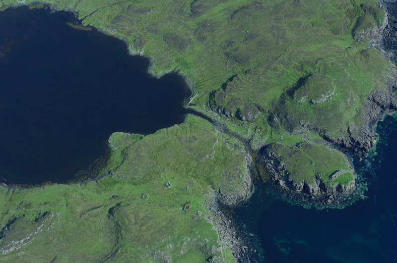 Aerial photograph of the canal and headland fort from the SW. The cleared channel towards the mouth of the canal is evident. (Colin Martin)