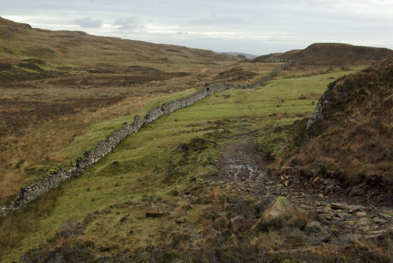 The Slochd Dubh – Black Dyke – a stone wall running from one side of the Rubh' an Dùnain peninsula to the other, evidently defining a territorial boundary. Though the present wall is relatively ...