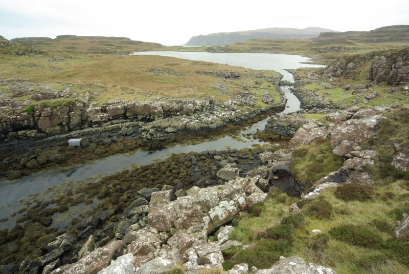 The upper canal leading into Loch na h-Airde. The naust entrances are partly obscured (centre right), while the blockage of the canal towards its entrance into the loch is clear. (Colin Martin)
