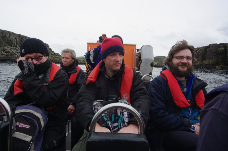 Fast, comfortable access is available – at a price – by rigid inflatable boat from Elgol. This occasion, in 2012, was underwritten by the BBC, who were making a programme. At centre is Dr Jon Henderson (University of Nottingham) who was presenting the programme and providing expertise on the archaeology of the site. On the right is Edward Martin, who has been developing drone photography and photographic rectification for the project. (Colin Martin)