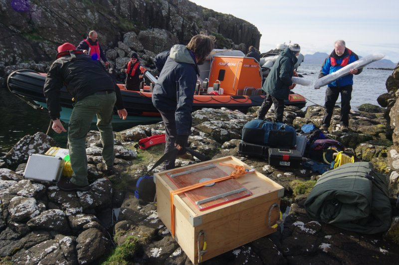 Filming, archaeological, and aerial drone equipment come ashore at Rubh' an Dùnain. The drone system is in the box, centre foreground. (Colin Martin)