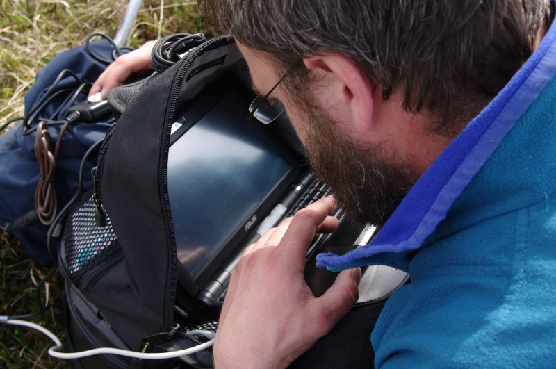 Edward Martin composing the picture and adjusting the camera on the elevated pole-mounted camera system from his computer on the ground. (Colin Martin)