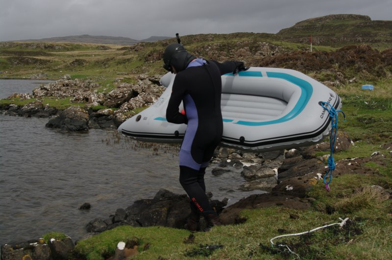 Attempts have been made to search the shallow loch bed, since it is likely that further early boat components will be found there. The simplest method has been to use a small inflatable raft pulled along rope lanes stretched across the loch by a snorkeller. (Colin Martin)