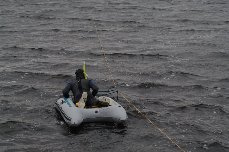 Attempts have been made to search the shallow loch bed, since it is likely that further early boat components will be found there. The simplest method has been to use a small inflatable raft pulled al ...