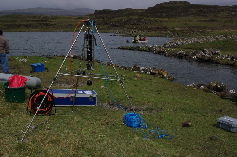 Trials have been made using sector scanning to search the loch bed for archaeological features. The equipment is seen here assembled and ready for launching. (Colin Martin)