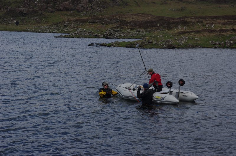 Trials have been made using sector scanning to search the loch bed for archaeological features. The equipment is seen here being positioned. Results so far have been encouraging, but a more sustained programme is required. (Colin Martin)