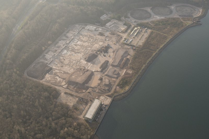 Oblique aerial view of the remains of Inverkip power station during post-demolition clearance, looking to the SW.