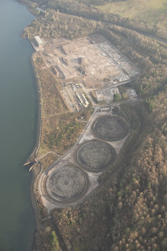 General oblique aerial view of the remains of Inverkip power station during post-demolition clearance, looking to the NE.