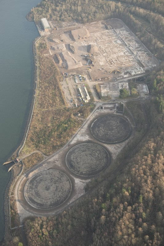 General oblique aerial view of the remains of Inverkip power station during post-demolition clearance, looking to the NNE.