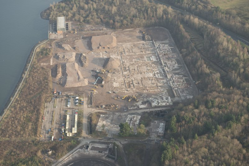 Oblique aerial view of the remains of Inverkip power station during post-demolition clearance, looking to the ENE.