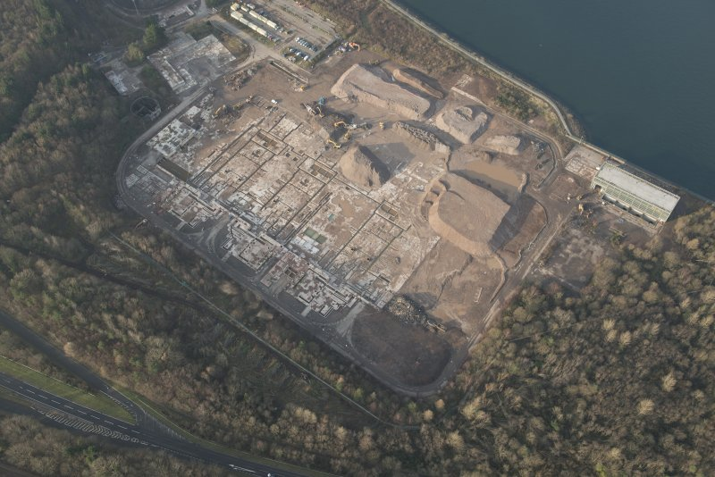 Oblique aerial view of the remains of Inverkip power station during post-demolition clearance, looking to the WNW.