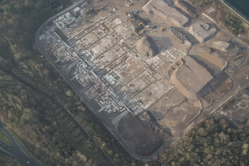 Oblique aerial view of the remains of Inverkip power station during post-demolition clearance, looking to the W.
