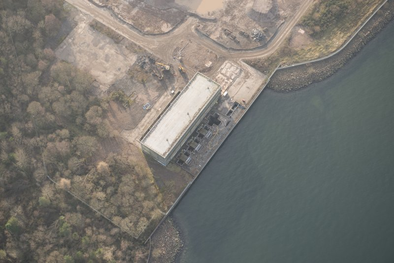 Oblique aerial view of the remains of Inverkip power station during post-demolition clearance, looking to the SSW.