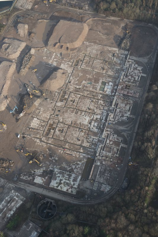 Oblique aerial view of the remains of Inverkip power station during post-demolition clearance, looking to the NNE.