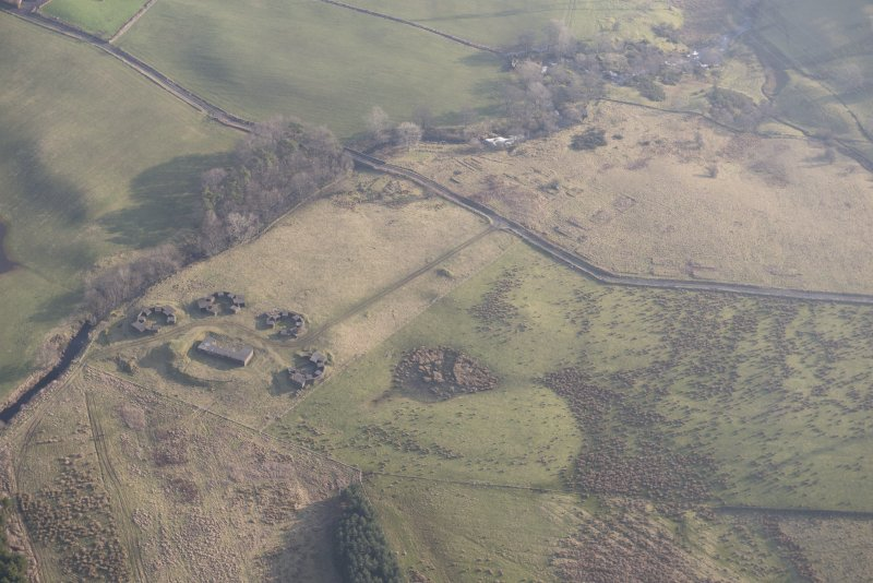Oblique aerial view of the remains of High Mathernock anti aircraft battery and accommodation camp, looking to the ESE.