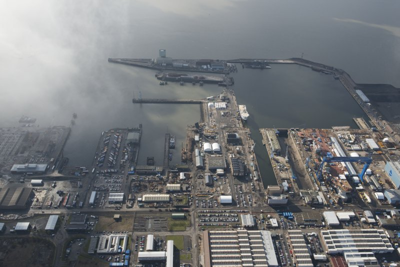 Oblique aerial view of Rosyth Dockyard showing the construction of the new aircraft carrier, HMS Queen Elizabeth, looking SSW.