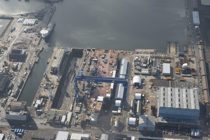 Oblique aerial view of Rosyth Dockyard showing the construction of the new aircraft carrier, HMS Queen Elizabeth, looking S.
