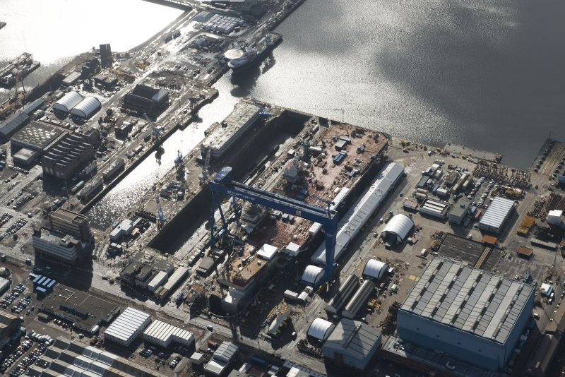 Oblique aerial view of Rosyth Dockyard showing the construction of the new aircraft carrier, HMS Queen Elizabeth, looking SSE.