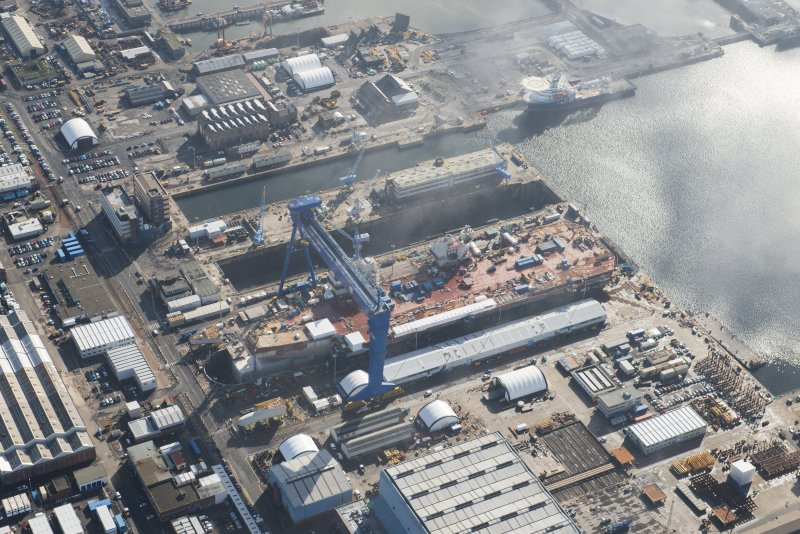 Oblique aerial view of Rosyth Dockyard showing the construction of the new aircraft carrier, HMS Queen Elizabeth, looking SE.