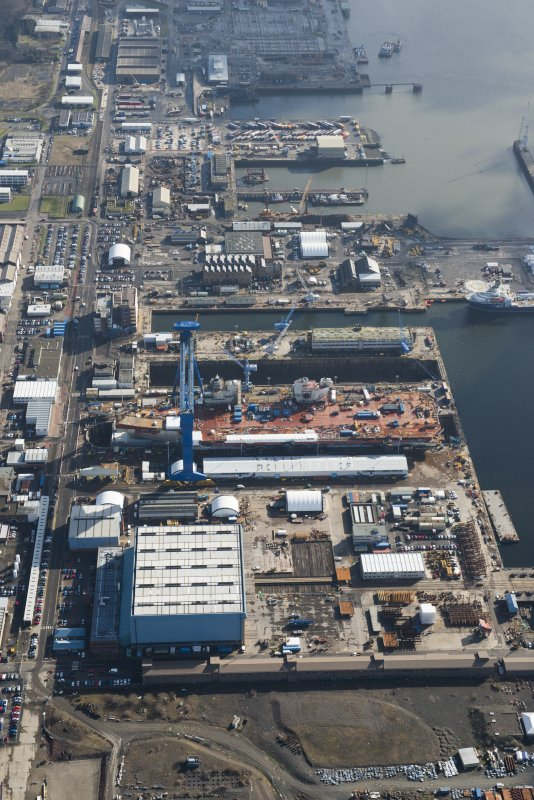 Oblique aerial view of Rosyth Dockyard showing the construction of the new aircraft carrier, HMS Queen Elizabeth, looking ESE.
