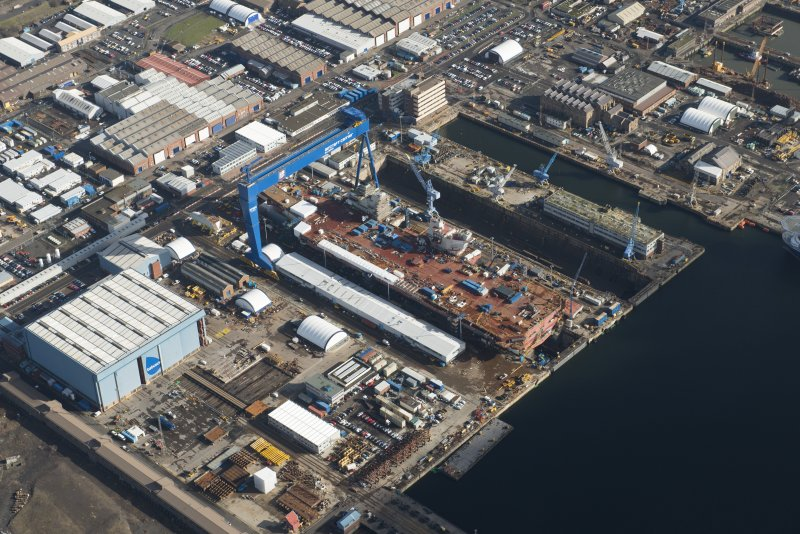 Oblique aerial view of Rosyth Dockyard showing the construction of the new aircraft carrier, HMS Queen Elizabeth, looking NNE.