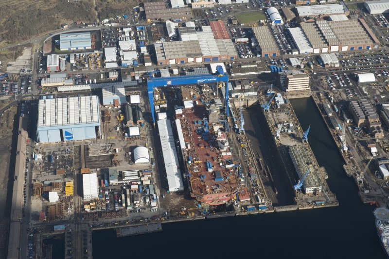 Oblique aerial view of Rosyth Dockyard showing the construction of the new aircraft carrier, HMS Queen Elizabeth, looking NE.