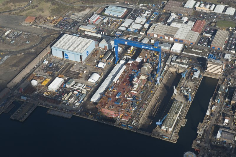 Oblique aerial view of Rosyth Dockyard showing the construction of the new aircraft carrier, HMS Queen Elizabeth, looking N.