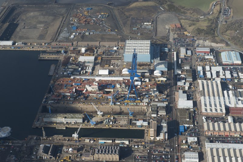 Oblique aerial view of Rosyth Dockyard showing the construction of the new aircraft carrier, HMS Queen Elizabeth, looking WNW.