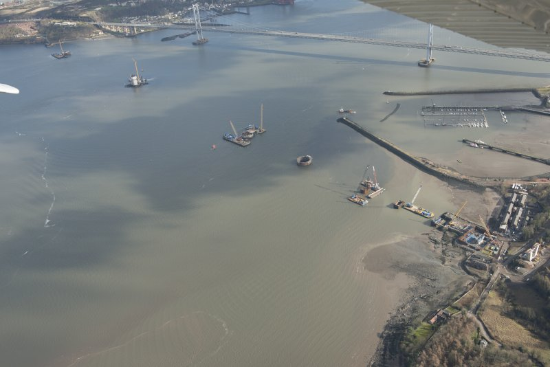 Oblique aerial view of the construction of the new Queensferry crossing at Inchgarvie House, looking E.
