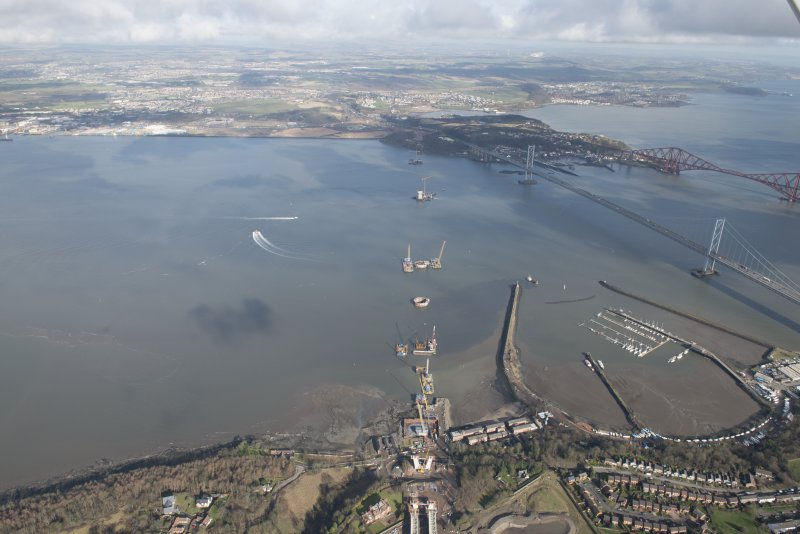 General oblique aerial view of the construction of the Queensferry, the Forth Road Bridge and Port Edgar, looking N.